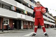 17 June 2020; NOW TV surprised Liverpool superfan Sean McCabe (11) and the residents of Canon Mooney Gardens in Ringsend with a special message from Liverpool legend Jamie Carragher. To show its appreciation for their enduring community spirit, NOW TV also gifted all residents with NOW TV Sky Sports Passes so that they can watch the returning football games. Premier League action returns with a double-header today and all the action is available to stream on NOW TV. Pictured is Sean McCabe in Canon Mooney Gardens in Dublin. Photo by Sam Barnes/Sportsfile