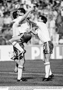 21 June 1990; Niall Quinn of Republic of Ireland, left, is congratulated by team-mates Ray Houghton, centre, and Ronnie Whelan after scoring their side's goal during the FIFA World Cup 1990 Group F match between Republic of Ireland and Netherlands at Stadio La Favorita in Palermo, Italy. Photo by Ray McManus/Sportsfile