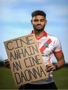 21 June 2020; An Ghaeltacht footballer Franz Sauerland holds a sign in Irish which reads 'Cine amháin An Cine Daonna', and translates in English to 'One race, the human race'. To The New Generation is a series of portraits of Black athletes in Ireland, representing their communities and families, and in some instances Ireland, in a variety of sports, including athletics, basketball, GAA, rugby and soccer. Their stories reflect a contemporary and multicultural Ireland and Ireland's place in the world, moving more and more from an emigrant nation to an immigrant nation offering hope and a life to many people from beyond our shores. Photo by Ramsey Cardy/Sportsfile