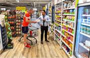 22 June 2020; Monaleen GAA player Daniel Power is assisted by Nathan Nahar, assistant manager, while shopping in SuperValu castletroy on behalf of The Sisters of the Little Company of Mary in Milford, Limerick. GAA clubs nationwide help out their local communities during restrictions imposed by the Irish Government in an effort to contain the spread of the Coronavirus (COVID-19) pandemic. GAA facilities reopened on Monday June 8 for the first time since March 25 with club matches provisionally due to start on July 31 and intercounty matches due to to take place no sooner that October 17. Photo by Eóin Noonan/Sportsfile
