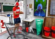 22 June 2020; Monaleen GAA player Daniel Power sanitizes before shopping in SuperValu castletroy on behalf of The Sisters of the Little Company of Mary in Milford, Limerick. GAA clubs nationwide help out their local communities during restrictions imposed by the Irish Government in an effort to contain the spread of the Coronavirus (COVID-19) pandemic. GAA facilities reopened on Monday June 8 for the first time since March 25 with club matches provisionally due to start on July 31 and intercounty matches due to to take place no sooner that October 17. Photo by Eóin Noonan/Sportsfile