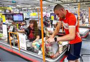 22 June 2020; Monaleen GAA player Daniel Power at the check out with Miriam Costello in SuperValu castletroy after shopping on behalf of The Sisters of the Little Company of Mary in Milford, Limerick. GAA clubs nationwide help out their local communities during restrictions imposed by the Irish Government in an effort to contain the spread of the Coronavirus (COVID-19) pandemic. GAA facilities reopened on Monday June 8 for the first time since March 25 with club matches provisionally due to start on July 31 and intercounty matches due to to take place no sooner that October 17. Photo by Eóin Noonan/Sportsfile