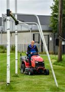 24 June 2020; Groundsman Criostoir Mac Cionnaith cuts the grass ahead of training sessions this evening at Setanta GAA Club in Ballymun, Dublin. Following approval from the GAA and the Irish Government, the GAA released its safe return to play protocols, allowing pitches to be opened for non contact training on 24 June and for training and challenge games to resume from 29 June. On March 25, the GAA announced the cessation of all GAA activities and closures of all GAA facilities under their jurisdiction upon directives from the Irish Government in an effort to contain the Coronavirus (COVID-19) pandemic. Photo by Seb Daly/Sportsfile