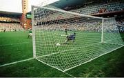 25 June 1990; Ray Houghton of Republic of Ireland scores his side's second penalty during the penalty shoot out during the FIFA World Cup 1990 Round of 16 match between Republic of Ireland and Romania at the Stadio Luigi Ferraris in Genoa, Italy. Photo by Ray McManus/Sportsfile