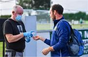 24 June 2020; Cully Hayden, Covid Supervisor, gives hand sanitiser to Kevin Murnaghan before a Moorefield Senior Football Squad training session at Moorefield GAA club in Newbridge, Kildare. Following approval from the GAA and the Irish Government, the GAA released its safe return to play protocols, allowing pitches to be opened for non contact training on 24 June and for training and challenge games to resume from 29 June. On March 25, the GAA announced the cessation of all GAA activities and closures of all GAA facilities under their jurisdiction upon directives from the Irish Government in an effort to contain the Coronavirus (COVID-19) pandemic. Photo by Piaras Ó Mídheach/Sportsfile