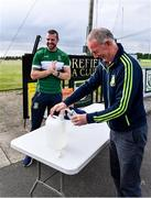 24 June 2020; Moorefield manager Ronan Sweeney, behind, applies hand sanitiser as Pat Flynn, member of Moorefield Executive, refills the bottles before a Moorefield Senior Football Squad training session at Moorefield GAA club in Newbridge, Kildare. Following approval from the GAA and the Irish Government, the GAA released its safe return to play protocols, allowing pitches to be opened for non contact training on 24 June and for training and challenge games to resume from 29 June. On March 25, the GAA announced the cessation of all GAA activities and closures of all GAA facilities under their jurisdiction upon directives from the Irish Government in an effort to contain the Coronavirus (COVID-19) pandemic. Photo by Piaras Ó Mídheach/Sportsfile
