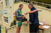 25 June 2020; Michael Murphy receives sanitizer from team offical Paul Gallagher on arrival to a Glenswilly GAA Club training session at Glenkerragh in Donegal. Following approval from the GAA and the Irish Government, the GAA released its safe return to play protocols, allowing pitches to be opened for non contact training on 24 June and for training and challenge games to resume from 29 June. On March 25, the GAA announced the cessation of all GAA activities and closures of all GAA facilities under their jurisdiction upon directives from the Irish Government in an effort to contain the Coronavirus (COVID-19) pandemic. Photo by Oliver McVeigh/Sportsfile