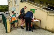 25 June 2020; Paul Gallagher, team offical, completing health forms and sanitizing the officalls and players before a Glenswilly GAA Club training session at Glenkerragh in Donegal. Following approval from the GAA and the Irish Government, the GAA released its safe return to play protocols, allowing pitches to be opened for non contact training on 24 June and for training and challenge games to resume from 29 June. On March 25, the GAA announced the cessation of all GAA activities and closures of all GAA facilities under their jurisdiction upon directives from the Irish Government in an effort to contain the Coronavirus (COVID-19) pandemic. Photo by Oliver McVeigh/Sportsfile