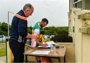 25 June 2020; Paul Gallagher, team offical, sanitizes the officals and players before a Glenswilly GAA Club training session at Glenkerragh in Donegal. Following approval from the GAA and the Irish Government, the GAA released its safe return to play protocols, allowing pitches to be opened for non contact training on 24 June and for training and challenge games to resume from 29 June. On March 25, the GAA announced the cessation of all GAA activities and closures of all GAA facilities under their jurisdiction upon directives from the Irish Government in an effort to contain the Coronavirus (COVID-19) pandemic. Photo by Oliver McVeigh/Sportsfile