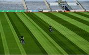 26 June 2020; Croke Park's groundsman Colm Daly, left, cuts the pitch at Croke Park in Dublin. The GAA announced that inter-county fixtures will resume on October 17. Following approval from the GAA and the Irish Government, the GAA released its safe return to play protocols, allowing pitches to be opened for training and challenge games from 29 June. On March 25, the GAA announced the cessation of all GAA activities and closures of all GAA facilities under their jurisdiction upon directives from the Irish Government in an effort to contain the Coronavirus (COVID-19) pandemic. Photo by Ramsey Cardy/Sportsfile