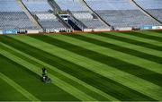 26 June 2020; Croke Park's groundsman Colm Daly cuts the pitch at Croke Park in Dublin. The GAA announced that inter-county fixtures will resume on October 17. Following approval from the GAA and the Irish Government, the GAA released its safe return to play protocols, allowing pitches to be opened for training and challenge games from 29 June. On March 25, the GAA announced the cessation of all GAA activities and closures of all GAA facilities under their jurisdiction upon directives from the Irish Government in an effort to contain the Coronavirus (COVID-19) pandemic. Photo by Ramsey Cardy/Sportsfile
