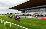 26 June 2020; A general view as Merchants Quay, right, with Wayne Lordan up, passes the post to win the Irish Stallion Farms EBF (C & G) Maiden during day one of the Dubai Duty Free Irish Derby Festival at The Curragh Racecourse in Kildare. Horse Racing continues behind closed doors following strict protocols having been suspended from March 25 due to the Irish Government's efforts to contain the spread of the Coronavirus (COVID-19) pandemic. Photo by Harry Murphy/Sportsfile