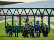 26 June 2020; A view of the field and stall handlers at the start of the Irish Stallion Farms EBF (C & G) Maiden during day one of the Dubai Duty Free Irish Derby Festival at The Curragh Racecourse in Kildare. Horse Racing continues behind closed doors following strict protocols having been suspended from March 25 due to the Irish Government's efforts to contain the spread of the Coronavirus (COVID-19) pandemic. Photo by Seb Daly/Sportsfile