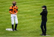 26 June 2020; Trainer Johnny Murtagh talks to jockey Ben Martin Coen ahead of the Irish Stallion Farms EBF Fillies Maiden, during day one of the Dubai Duty Free Irish Derby Festival at The Curragh Racecourse in Kildare. Horse Racing continues behind closed doors following strict protocols having been suspended from March 25 due to the Irish Government's efforts to contain the spread of the Coronavirus (COVID-19) pandemic. Photo by Harry Murphy/Sportsfile