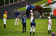 26 June 2020; Trainer Joseph O'Brien, second from left, and his brother Donnacha O'Brien, third from left, speak to the jockeys ahead of the Irish Stallion Farms EBF Fillies Maiden, during day one of the Dubai Duty Free Irish Derby Festival at The Curragh Racecourse in Kildare. Horse Racing continues behind closed doors following strict protocols having been suspended from March 25 due to the Irish Government's efforts to contain the spread of the Coronavirus (COVID-19) pandemic. Photo by Harry Murphy/Sportsfile