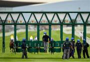 26 June 2020; A stall handler dismounts from the stalls following the start of the Irish Stallion Farms EBF (C & G) Maiden during day one of the Dubai Duty Free Irish Derby Festival at The Curragh Racecourse in Kildare. Horse Racing continues behind closed doors following strict protocols having been suspended from March 25 due to the Irish Government's efforts to contain the spread of the Coronavirus (COVID-19) pandemic. Photo by Seb Daly/Sportsfile