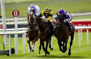 26 June 2020; Delphi, right, with Wayne Lordan up, passes the post to win The Irish Stallion Farms EBF (C & G) Maiden ahead of second place finisher Carrytheone, centre, with Shane Kelly up, during day one of the Dubai Duty Free Irish Derby Festival at The Curragh Racecourse in Kildare. Horse Racing continues behind closed doors following strict protocols having been suspended from March 25 due to the Irish Government's efforts to contain the spread of the Coronavirus (COVID-19) pandemic. Photo by Harry Murphy/Sportsfile