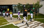 26 June 2020; Jockeys make their way to The Anglesey Lodge Equine Hospital Fillies Maiden during day one of the Dubai Duty Free Irish Derby Festival at The Curragh Racecourse in Kildare. Horse Racing continues behind closed doors following strict protocols having been suspended from March 25 due to the Irish Government's efforts to contain the spread of the Coronavirus (COVID-19) pandemic. Photo by Harry Murphy/Sportsfile
