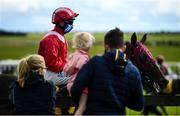 27 June 2020; Spectators look on as jockey Chris Hayes, on Linus Larrabee, make their way to the stalls ahead of the Dubai Duty Free Tennis Championships Handicap during day two of the Dubai Duty Free Irish Derby Festival at The Curragh Racecourse in Kildare. Horse Racing continues behind closed doors following strict protocols having been suspended from March 25 due to the Irish Government's efforts to contain the spread of the Coronavirus (COVID-19) pandemic. Photo by Harry Murphy/Sportsfile
