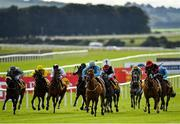 27 June 2020; Big Baby Bull, centre, with Joey Sheridan up, on their way to winning the Dubai Duty Free Millennium Millionaire Handicap during day two of the Dubai Duty Free Irish Derby Festival at The Curragh Racecourse in Kildare. Horse Racing continues behind closed doors following strict protocols having been suspended from March 25 due to the Irish Government's efforts to contain the spread of the Coronavirus (COVID-19) pandemic. Photo by Seb Daly/Sportsfile