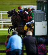 27 June 2020; Runners and riders exit the traps at the start of the Dubai Duty Free Millennium Millionaire Handicap during day two of the Dubai Duty Free Irish Derby Festival at The Curragh Racecourse in Kildare. Horse Racing continues behind closed doors following strict protocols having been suspended from March 25 due to the Irish Government's efforts to contain the spread of the Coronavirus (COVID-19) pandemic. Photo by Harry Murphy/Sportsfile