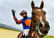 27 June 2020; Jockey Seamie Heffernan celebrates after riding Santiago to victory in the Dubai Duty Free Irish Derby during day two of the Dubai Duty Free Irish Derby Festival at The Curragh Racecourse in Kildare. Horse Racing continues behind closed doors following strict protocols having been suspended from March 25 due to the Irish Government's efforts to contain the spread of the Coronavirus (COVID-19) pandemic. Photo by Seb Daly/Sportsfile