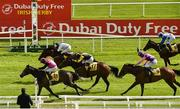 27 June 2020; Big Gossey, left, with Michael Hussey up, crosses the line ahead of second place Flaming Moon, top, with Robbie Colgan up, and third place Taggalo, 17, with Conor Hoban up, on their way to winning the Dubai Duty Free Tennis Championships Handicap during day two of the Dubai Duty Free Irish Derby Festival at The Curragh Racecourse in Kildare. Horse Racing continues behind closed doors following strict protocols having been suspended from March 25 due to the Irish Government's efforts to contain the spread of the Coronavirus (COVID-19) pandemic. Photo by Seb Daly/Sportsfile