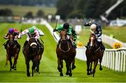 28 June 2020; Strong Johnson, with Colin Keane up, centre, race alongside eventual second Jungle Jane, with Billy Lee up, left, and eventual third Urban Beat, with Ben Coen up, right, on their way to winning the Paddy Power Rockingham Handicap race race during day three of the Dubai Duty Free Irish Derby Festival at The Curragh Racecourse in Kildare. Horse Racing continues behind closed doors following strict protocols having been suspended from March 25 due to the Irish Government's efforts to contain the spread of the Coronavirus (COVID-19) pandemic. Photo by David Fitzgerald/Sportsfile