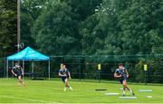 29 June 2020; Garry Ringrose, left, Rowan Osborne, centre, and Hugo Keenan during Leinster rugby squad training at UCD in Dublin. Rugby teams have been approved for return of restricted training under IRFU and the Irish Government's Roadmap for Reopening of Society and Business following strict protocols allowing it to return in a phased manner, having been suspended since March due to the Irish Government's efforts to contain the spread of the Coronavirus (COVID-19) pandemic. Photo by Marcus Ó Buachalla for Leinster Rugby via Sportsfile