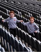 29 June 2020; Twins Thomas, left, and Daniel Gribbin, aged 7 from Castledawson in Derry celebrate the reopening of the GAA Museum and Tours at Croke Park. The inspiring Stadium Tour, thrilling Skyline Tour and treasured GAA Museum are now open to the public. With the GAA All-Ireland Senior Championships postponed until October, this is your only chance to visit Croke Park this summer, making them this season's hottest tickets! For more see www.crokepark.ie/tours Photo by Sam Barnes/Sportsfile