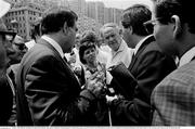 25 June 1990; Officials, including FAI official Donie Butler, right, speak as Republic of Ireland queue for match tickets prior to the FIFA World Cup 1990 Round of 16 match between Republic of Ireland and Romania at the Stadio Luigi Ferraris in Genoa, Italy. Photo by Ray McManus/Sportsfile