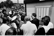 25 June 1990; FAI official Donie Butler speaks to Republic of Ireland supporters as they queue for match tickets prior to the FIFA World Cup 1990 Round of 16 match between Republic of Ireland and Romania at the Stadio Luigi Ferraris in Genoa, Italy. Photo by Ray McManus/Sportsfile