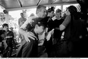 25 June 1990; FAI Honorary Treasurer Joe Delaney as Republic of Ireland supporters queue for match tickets prior to the FIFA World Cup 1990 Round of 16 match between Republic of Ireland and Romania at the Stadio Luigi Ferraris in Genoa, Italy. Photo by Ray McManus/Sportsfile