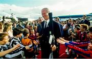 1 July 1990; Republic of Ireland manager Jack Charlton is greeted by young foorballers on his squad's arrival home for a homecoming reception after their participation in the 1990 FIFA World Cup Finals in Italy. Photo by Ray McManus/Sportsfile