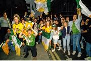 1 July 1990; Republic of Ireland supporters cheer on their team as they are brought by open top bus from Dublin Airport to College Green in Dublin city centre on their arrival home for a homecoming reception after their participation in the 1990 FIFA World Cup Finals in Italy. Photo by Ray McManus/Sportsfile