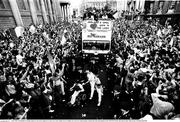 1 July 1990; The Republic of Ireland squad are cheered by supporters as they arrive into College Green in Dublin city centre for a homecoming reception after their participation in the 1990 FIFA World Cup Finals in Italy. Photo by Ray McManus/Sportsfile