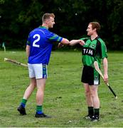 30 June 2020; Team captains Killian Haverty of St Sylvester's, left, and John Meehan of St Patrick's Donabate elbow bump ahead of the Junior B Hurling Challenge game between St Sylvester's and St Patrick's Donabate at Malahide Castle Pitches in Dublin. Photo by Piaras Ó Mídheach/Sportsfile