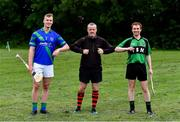 30 June 2020; Referee Robert Fennelly with team captains Killian Haverty of St Sylvester's, left, and John Meehan of St Patrick's Donabate elbow bump before the coin toss ahead of the Junior B Hurling Challenge game between St Sylvester's and St Patrick's Donabate at Malahide Castle Pitches in Dublin. Photo by Piaras Ó Mídheach/Sportsfile