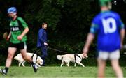 30 June 2020; A man walks his dogs past the action during the Junior B Hurling Challenge game between St Sylvester's and St Patrick's Donabate at Malahide Castle Pitches in Dublin. Photo by Piaras Ó Mídheach/Sportsfile