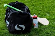 30 June 2020; The individual water bottle and spare hurl of a player near his gearbag on the sideline during the Junior B Hurling Challenge game between St Sylvester's and St Patrick's Donabate at Malahide Castle Pitches in Dublin. Photo by Piaras Ó Mídheach/Sportsfile