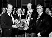 1 July 1990; Republic of Ireland manager Jack Charlton accepts a gift from An Tánaiste Tánaiste Brian Lenihan T.D., left, Minister of State at the Department of Education Frank Fahy, T.D., and Heiner Harding, Marketing Director of Galway Irish Crystal, right, during a homecoming reception on College Green in Dublin after their participation in the 1990 FIFA World Cup Finals in Italy. Photo by Ray McManus/Sportsfile