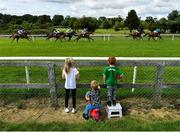 2 July 2020; Young spectators Kayla Murray, age 7, Sean, age 2, and Shay, age 4, from Duleek, watch as the field passes during the Irish EBF Median Sires Series (C & G) Maiden at Bellewstown Racecourse in Collierstown, Meath. Horse Racing continues behind closed doors following strict protocols having been suspended from March 25 due to the Irish Government's efforts to contain the spread of the Coronavirus (COVID-19) pandemic. Photo by Seb Daly/Sportsfile
