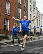 4 July 2020; Freeman of Dublin and former Dublin senior men's team manager Jim Gavin runs to the finish line held by Dublin footballer and secretary of The Dublin Neurological Institute Rebecca McDonnell during the Dublin Neurological Institute 150km Frontline Run at Eccles Street in Dublin. The DNI is a registered charity where we care for patients with neurological diseases including Parkinson, Epilepsy, Motor Neuron Disease, Multiple Sclerosis, Headache, Stroke and many more is holding hold a fundraising run with staff members running this weekend to raise much needed funds. The goal is to run 150km between staff over the course of Saturday the 4th and Sunday the 5th of July. Donations can be made at https://tinyurl.com/yd3a4d8d . The run can be tracked using the free app 'Map My Run' and anyone who wishes to join in the run is very welcome. Photo by David Fitzgerald/Sportsfile