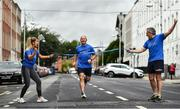 4 July 2020; Freeman of Dublin and former Dublin senior men's team manager Jim Gavin runs to the finish line held by Dublin footballer and secretary of The Dublin Neurological Institute Rebecca McDonnell and Professor Tim Lynch during the Dublin Neurological Institute 150km Frontline Run at Eccles Street in Dublin. The DNI is a registered charity where we care for patients with neurological diseases including Parkinson, Epilepsy, Motor Neuron Disease, Multiple Sclerosis, Headache, Stroke and many more is holding hold a fundraising run with staff members running this weekend to raise much needed funds. The goal is to run 150km between staff over the course of Saturday the 4th and Sunday the 5th of July. Donations can be made at https://tinyurl.com/yd3a4d8d . The run can be tracked using the free app 'Map My Run' and anyone who wishes to join in the run is very welcome. Photo by David Fitzgerald/Sportsfile