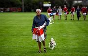 9 July 2020; Fingallians club member Charlie Rogan, followed by his dog Kenny, picks up the sideline flags after the Senior Football Club Challenge match between Fingallians and Clontarf at Lawless Memorial Park in Swords, Dublin. Photo by Stephen McCarthy/Sportsfile