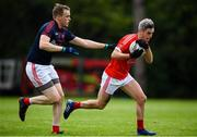9 July 2020; Patrick O'Neill of Fingallians in action against Morgan Walsh of Clontarf during the Senior Football Club Challenge match between Fingallians and Clontarf at Lawless Memorial Park in Swords, Dublin. Photo by Stephen McCarthy/Sportsfile
