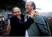 12 June 1988; Republic of Ireland manager Jack Charlton, right, and assistant manager Maurice Setters celebrate at the final whistle of the UEFA European Football Championship Finals Group B match between England and Republic of Ireland at Neckarstadion in Stuttgart, Germany. Photo by Ray McManus/Sportsfile