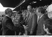 3 September 1989; Former Republic of Ireland manager Jack Charlton and former assistant manager Maurice Setters, right, arrive for the All-Ireland Senior Hurling Championship Final between Tipperary and Antrim at Croke Park in Dublin. Photo by Ray McManus/Sportsfile