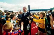 1 July 1990; Republic of Ireland manager Jack Charlton is greeted by young footballers on his squad's arrival home for a homecoming reception after their participation in the 1990 FIFA World Cup Finals in Italy. Photo by Ray McManus/Sportsfile