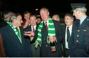 17 November 1993; Taoiseach Albert Reynolds T.D. welcomes Republic of Ireland manager Jack Charlton at Dublin Airport on the teams return from their 1-1 draw with Northern Ireland at Windsor Park in Belfast. Photo by Ray McManus/Sportsfile
